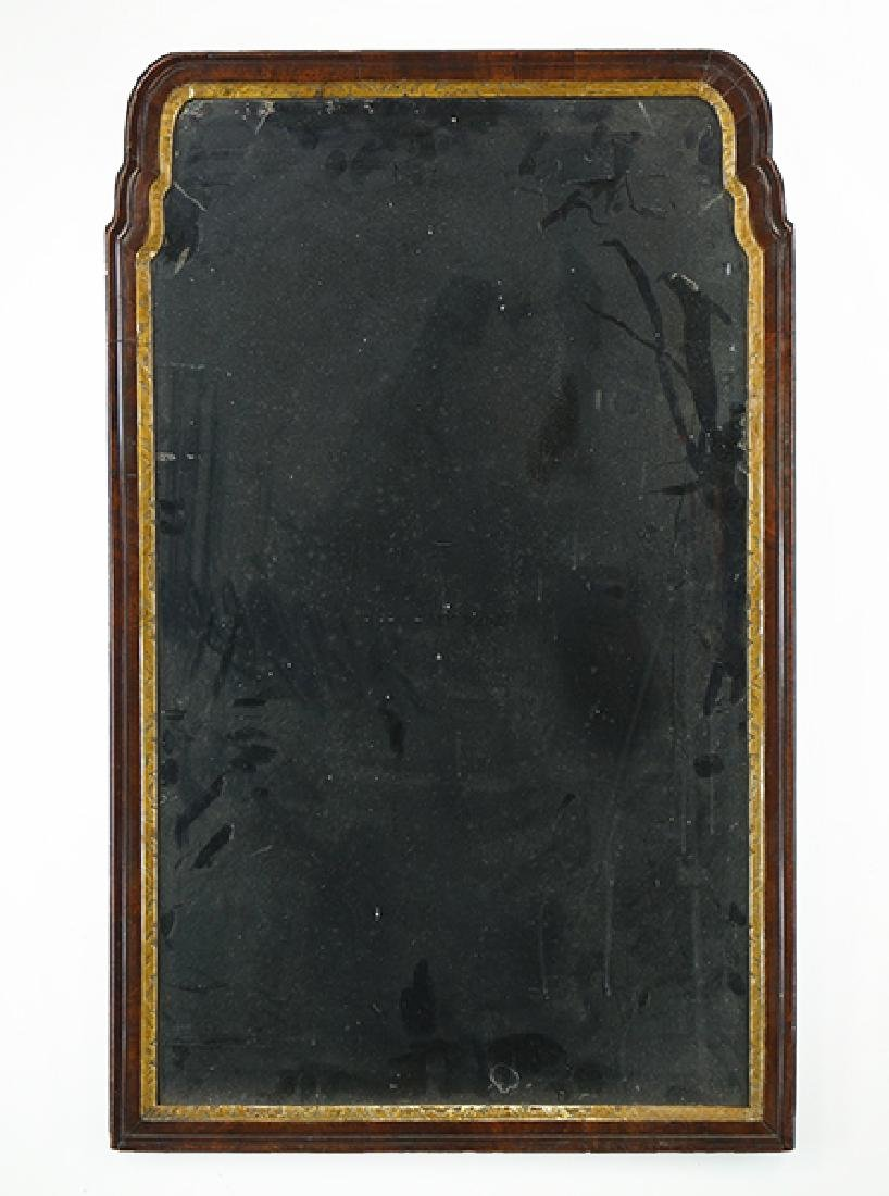 A Georgian Parcel Gilt Mahogany Mirror.
