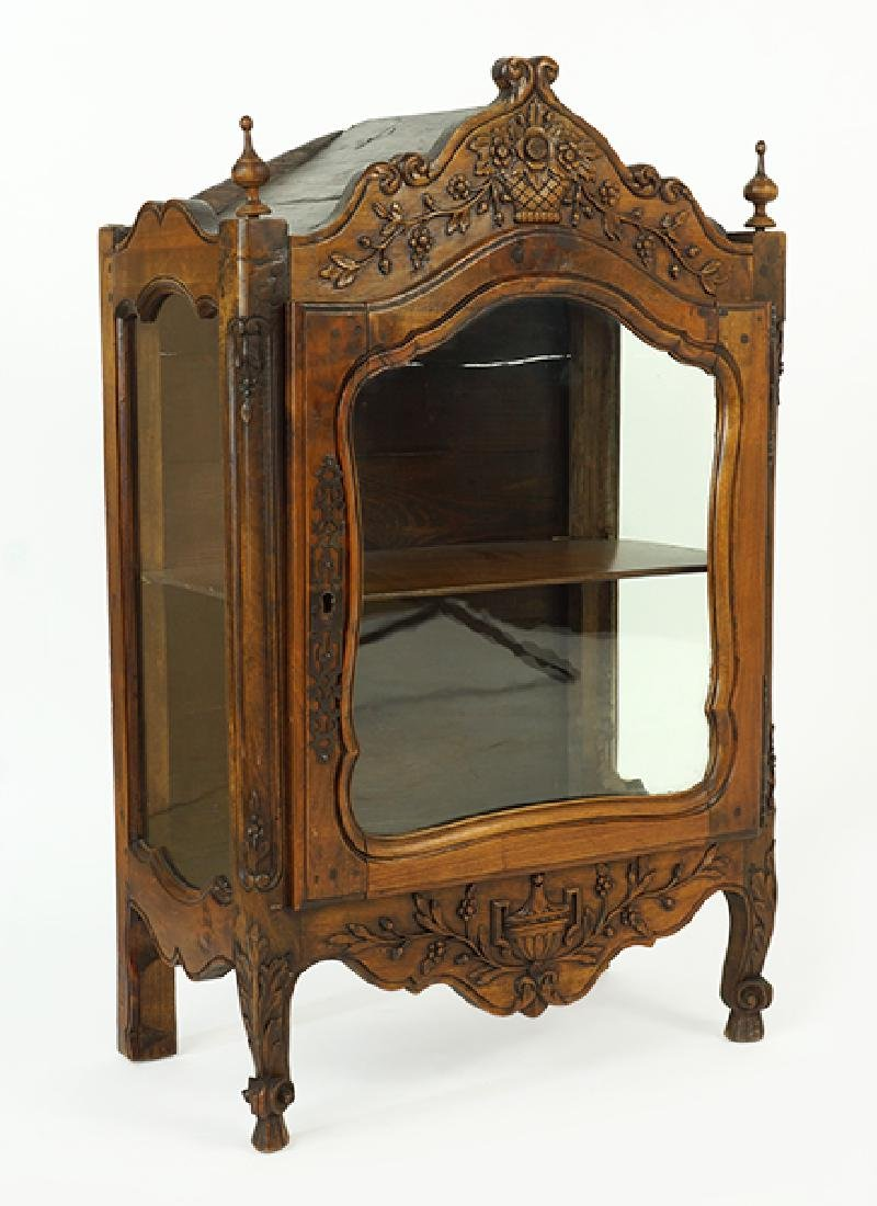 A Continental Carved Walnut Cabinet.