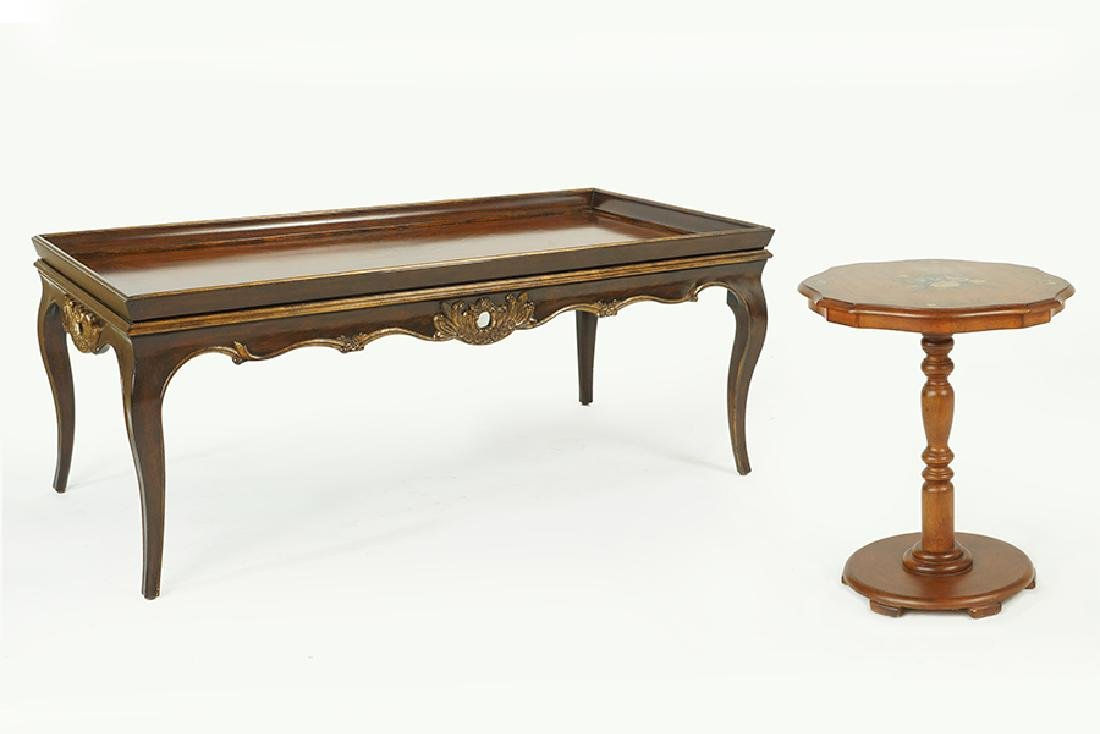 A Carved Wood Cocktail Table.