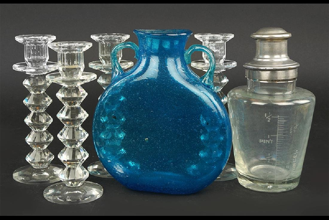A Set of Four Crystal Candlesticks.