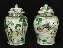 A Pair of Chinese Famille Verte Porcelain Covered Jars.