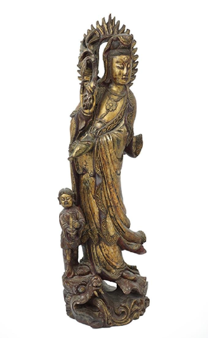 A Chinese Carved Wood Figure of Guan Yin.