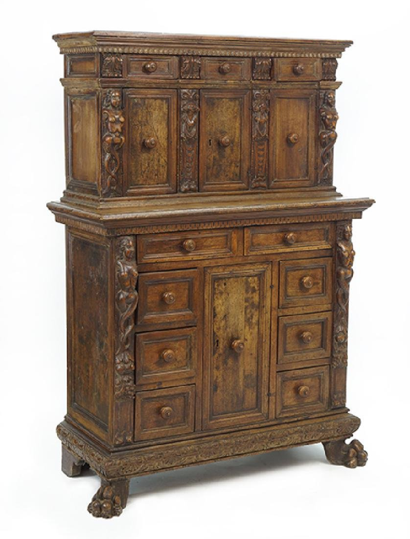 A Continental Carved Oak Cupboard.