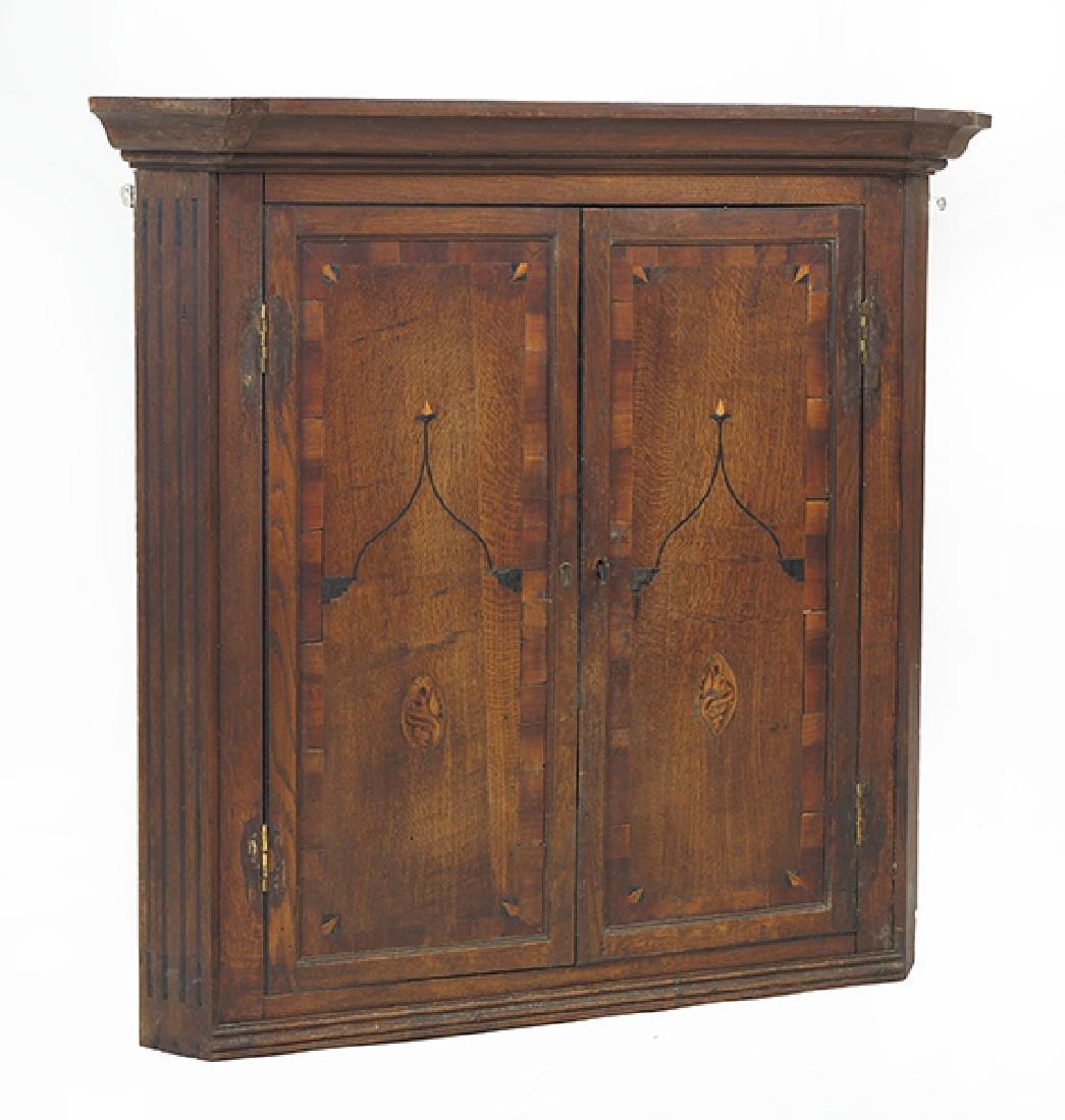 A Corner Cabinet.