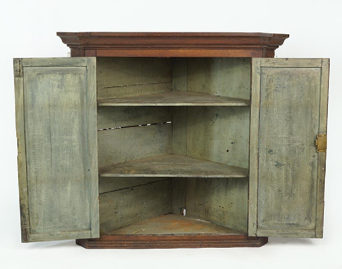 A Corner Cabinet. - 2