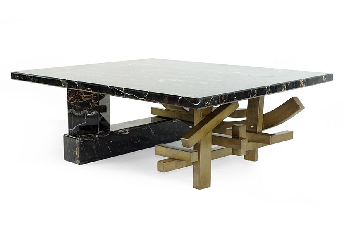 A Marble and Bronze Cocktail Table.