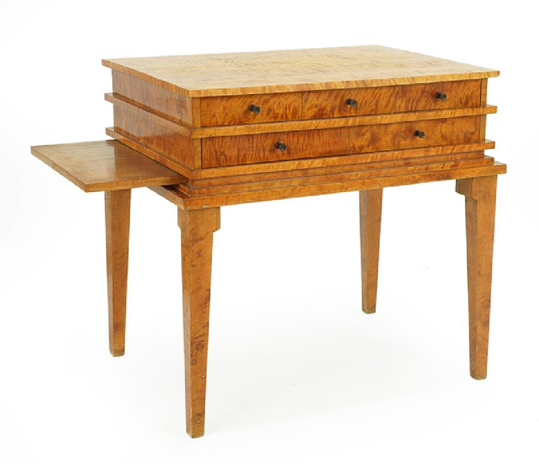 A Flame Birch Table. - 2