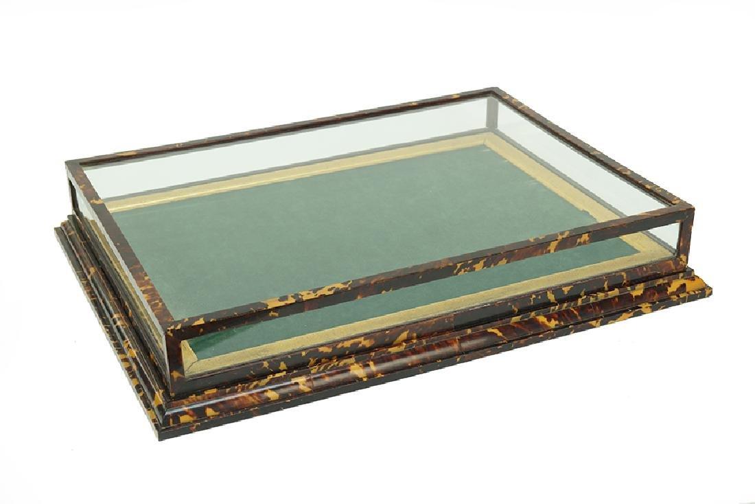 A Tortoiseshell Display Case.