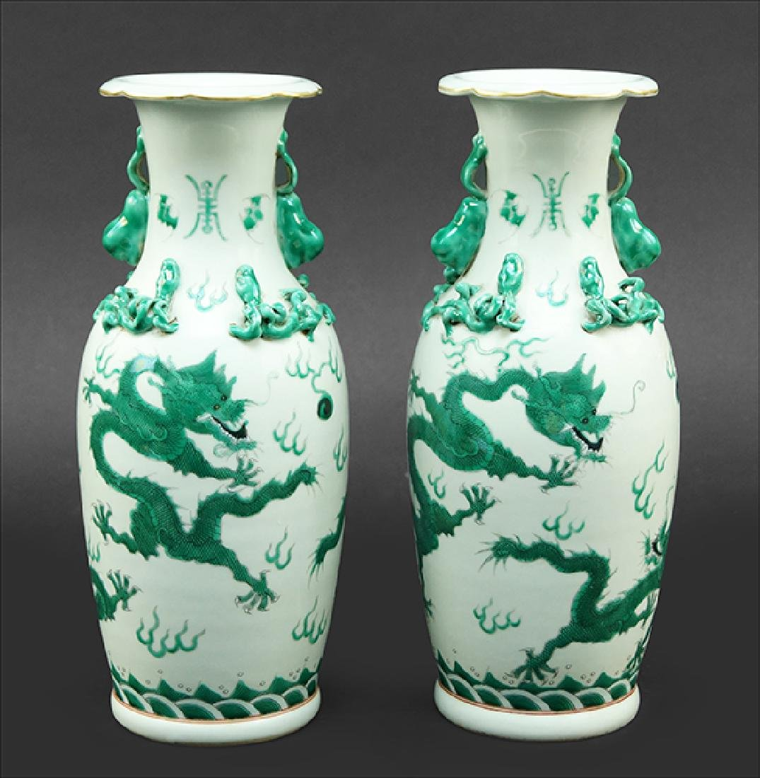 A Pair of Famille Verte Vases.