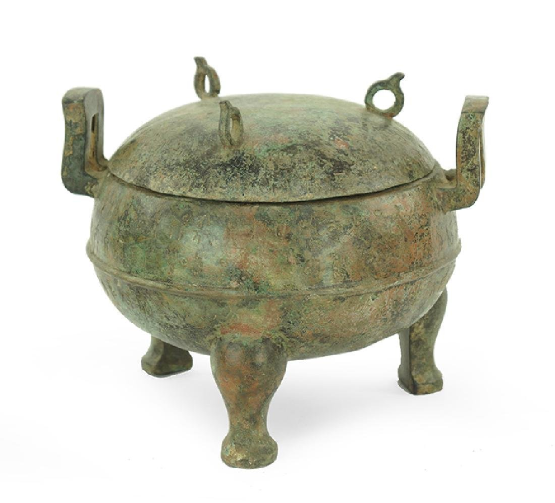 A Chinese Patinated Metal Ding Vessel.