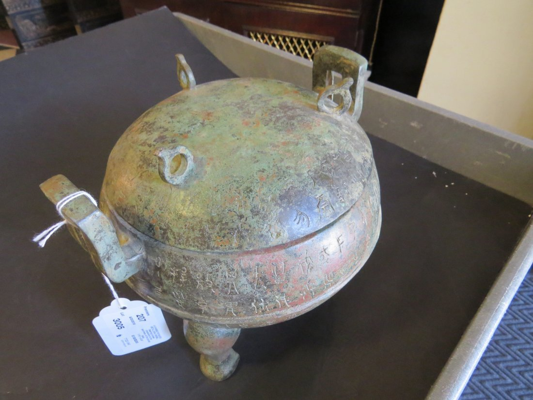 A Chinese Patinated Metal Ding Vessel. - 2