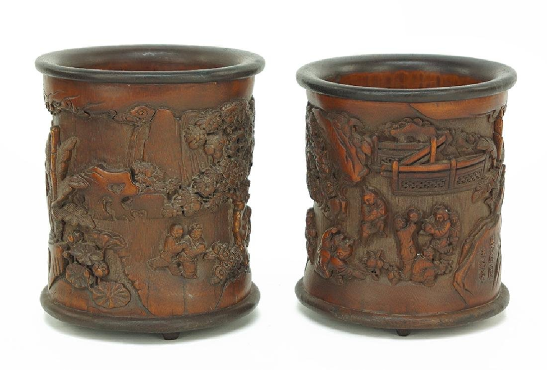 A Near Pair of Chinese Carved Bamboo Brush Pots.