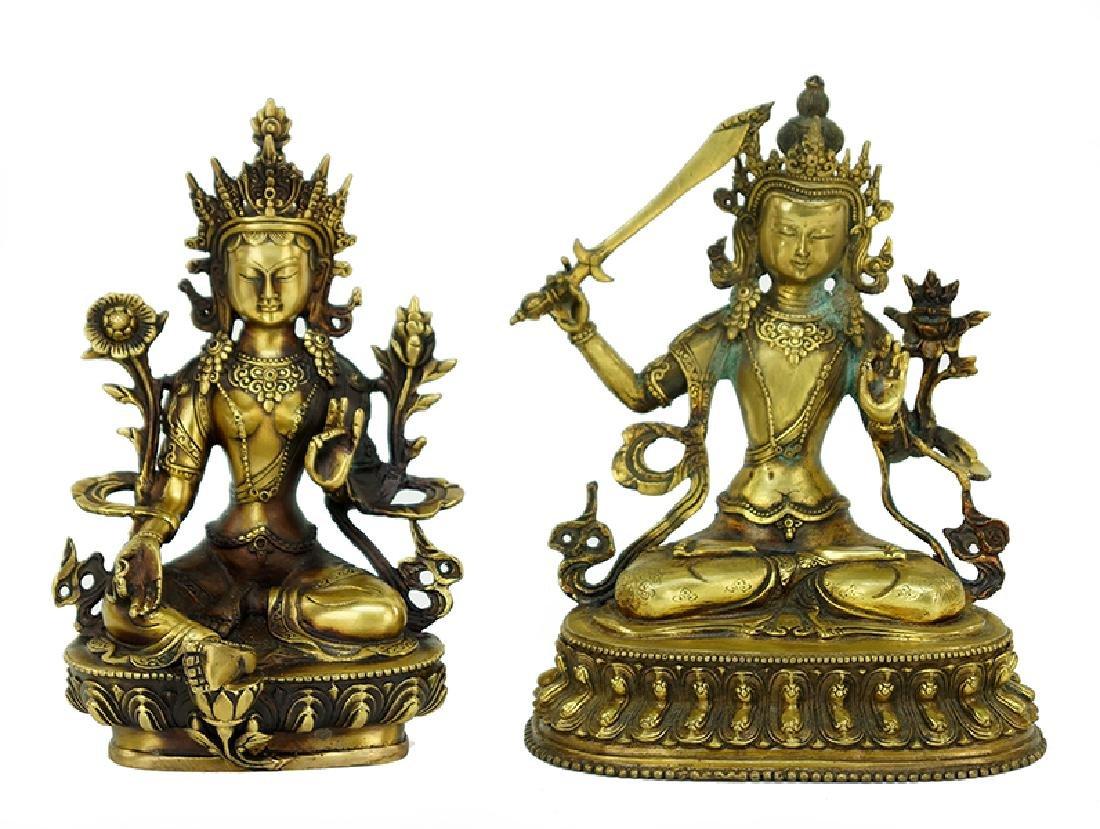 Two Chinese Patinated Brass Buddha Figures.