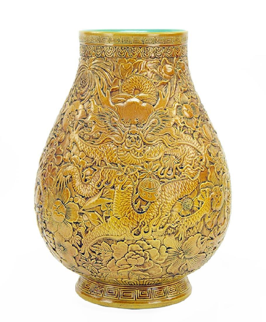 A Chinese Mustard Yellow Glazed Porcelain Hu Form Vase.
