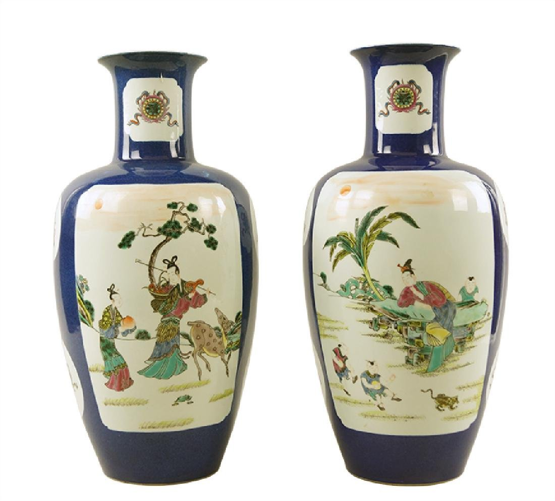 A Pair of Cobalt Ground Porcelain Baluster Vases.
