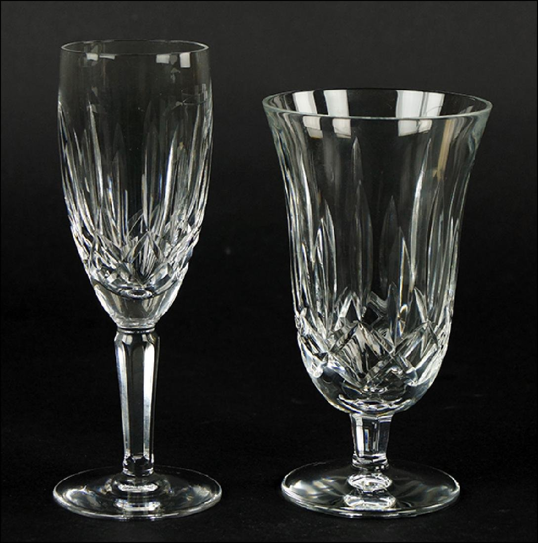 A Set Of Twelve Waterford Champagne Flutes.