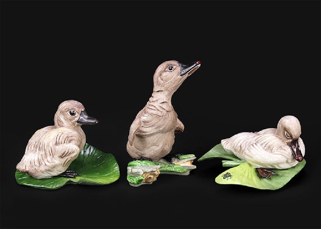 A Group Of Three Boehm Porcelain Swans.