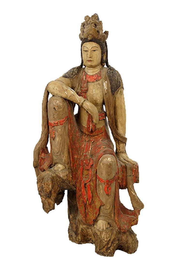 A Painted Plaster Figure of Quan Yin.