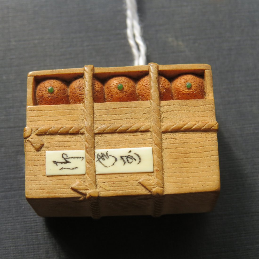 A Carved Wood Netsuke Depicting a Crate of Oranges. - 2