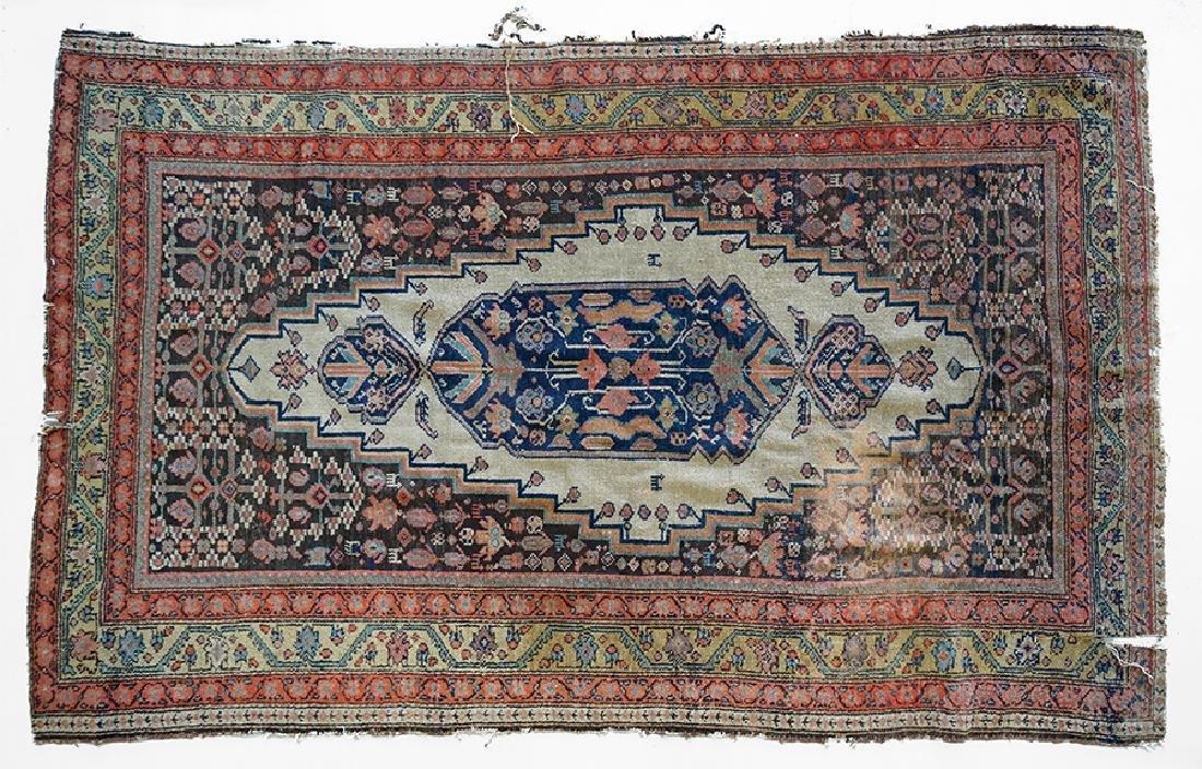 A Persian Wool Rug. - 2