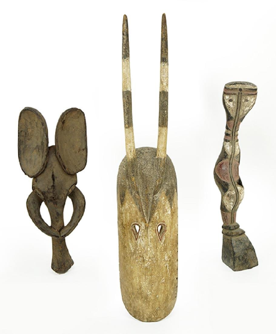 A Group Of Carved Wood African Pieces.