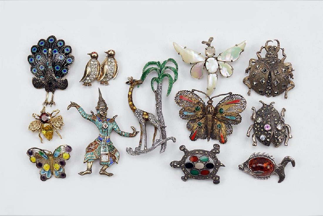 A Collection of Sterling Silver Brooches.
