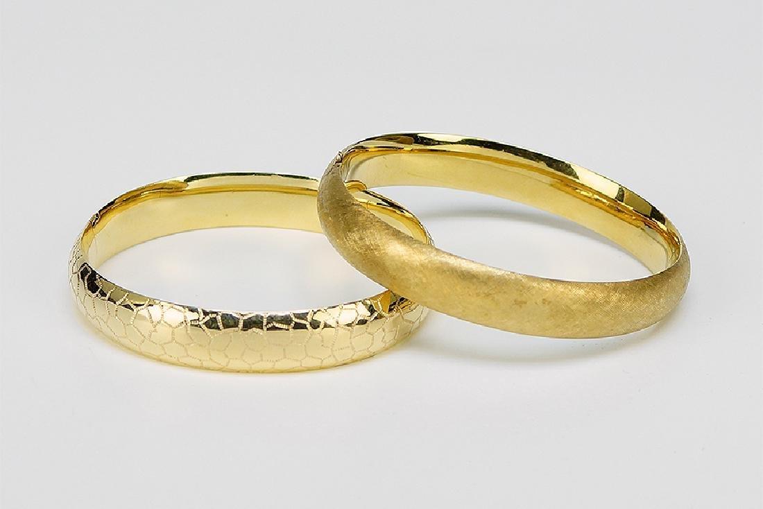 Two 14 Karat Yellow Gold Bangle Bracelets.