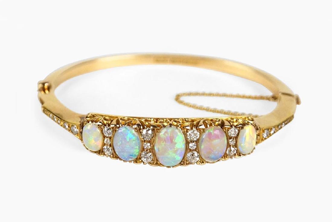 An English Opal, Diamond, and 15 Karat Yellow Gold