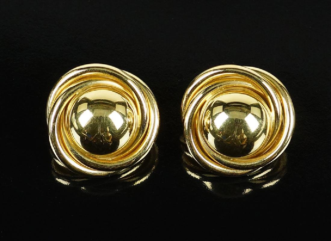 A Pair of Gold Earclips.