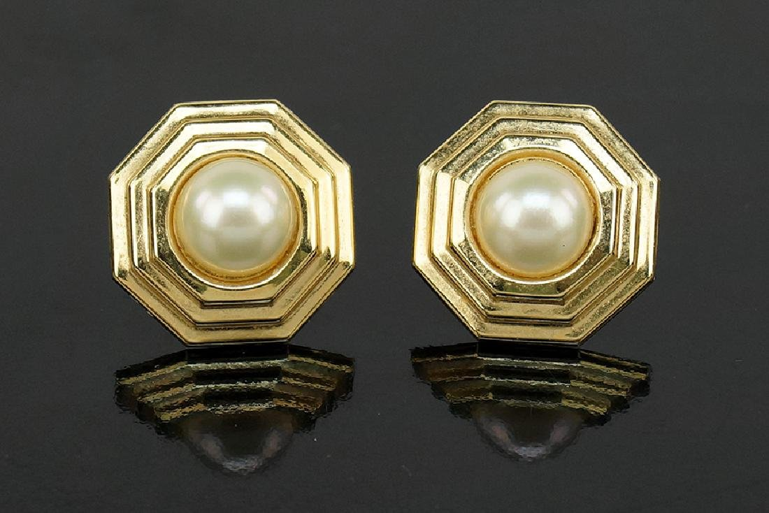 A Pair of Pearl and 14 Karat Yellow Gold Earrings.