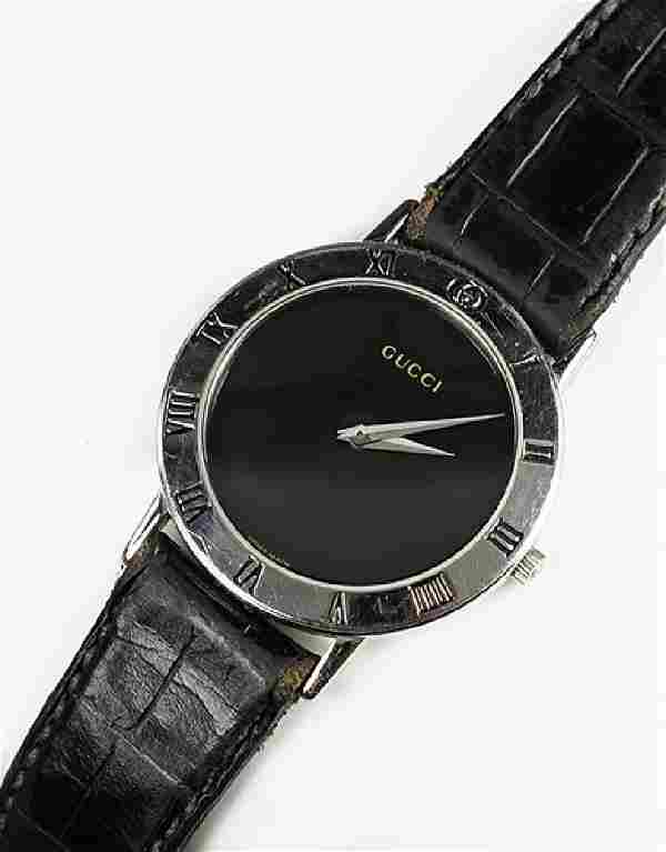 A Gucci Stainless Steel Watch.