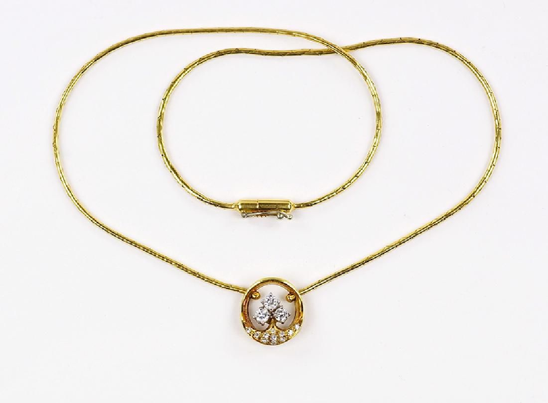 A Diamond and 18 Karat Gold Necklace.