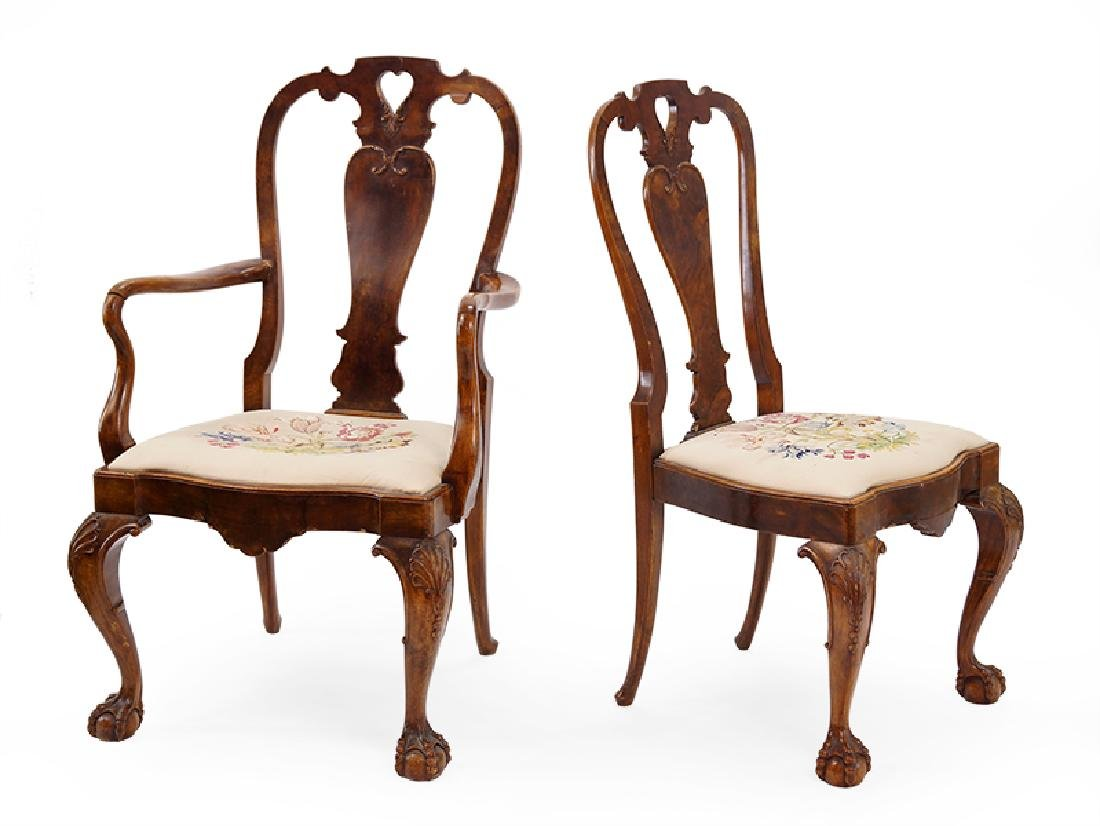 A Set Of Twelve Carved Mahogany Dining Chairs.