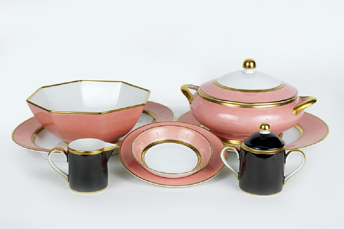 A Fitz and Floyd Porcelain Dinner Service.