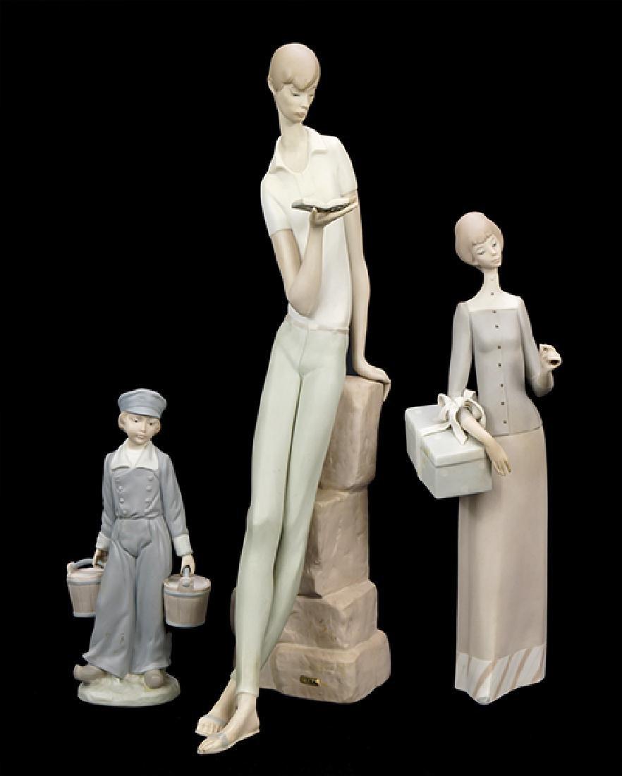 Three Lladro Matte Glazed Porcelain Figures.