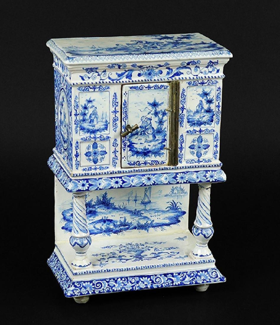 A Delft Porcelain Miniature Cabinet.