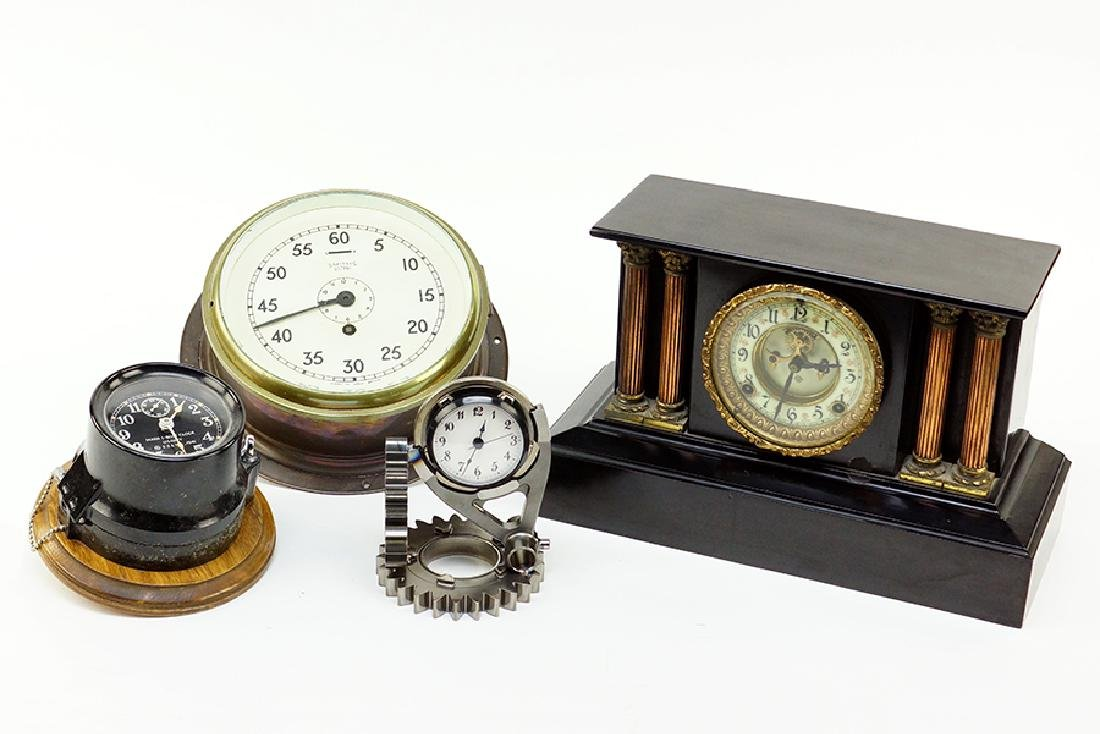 A Group Of Four Clocks.