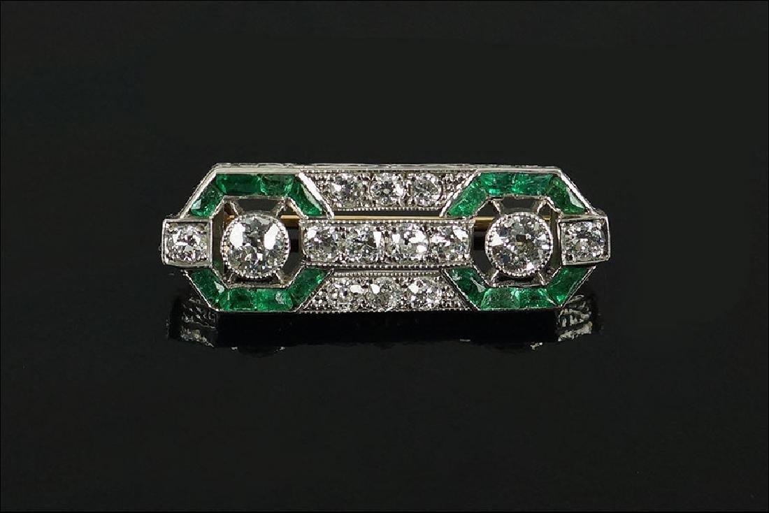 An Art Deco Diamond & Emerald Brooch.