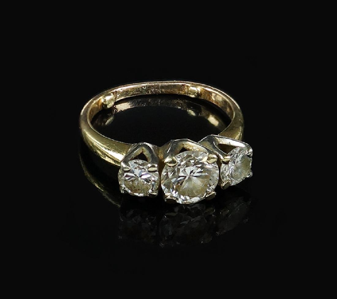A Three Stone Diamond Ring.