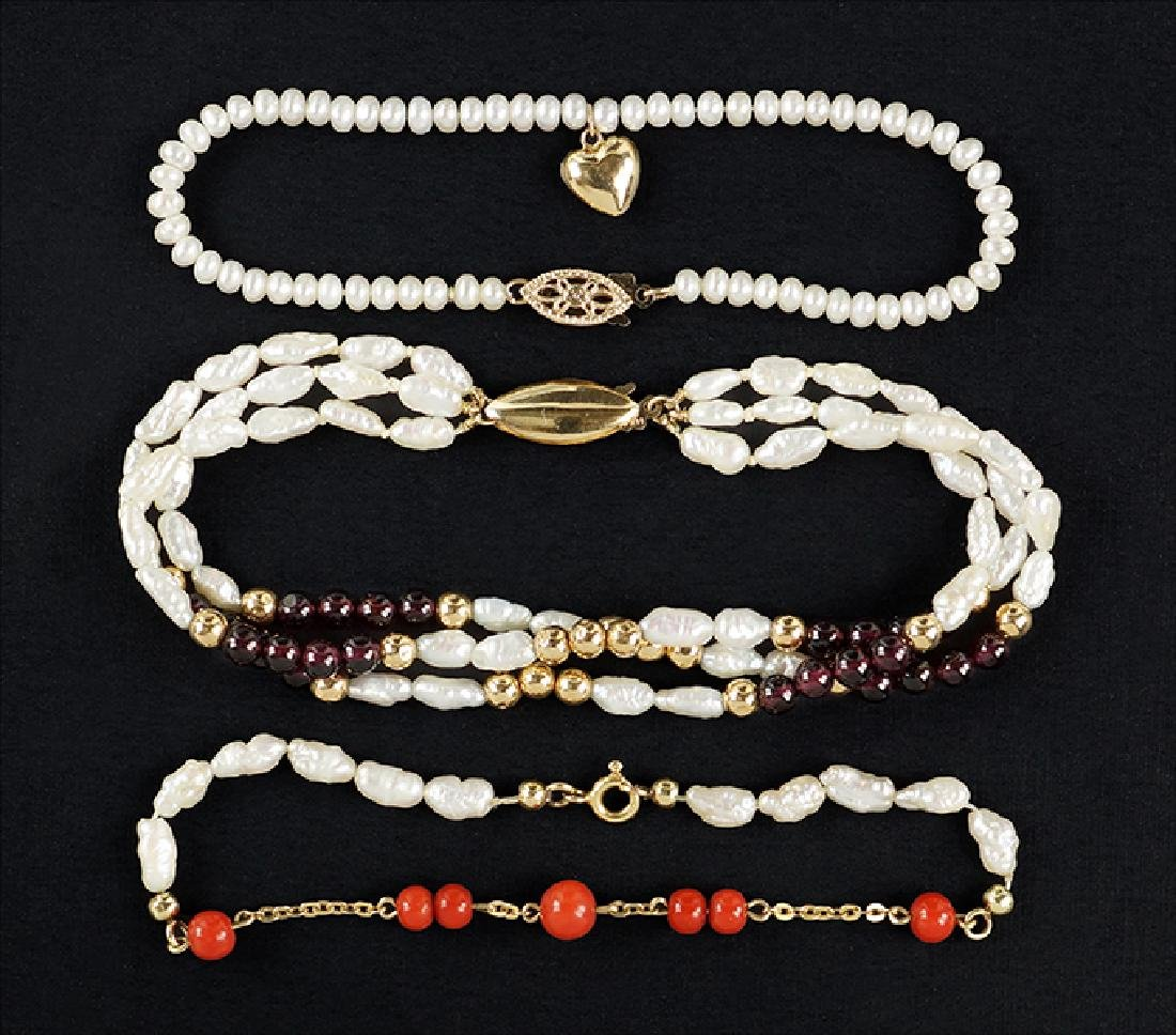 Three Pearl Bracelets.