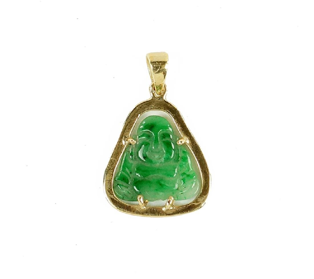 A Carved Jade Buddha Pendant.