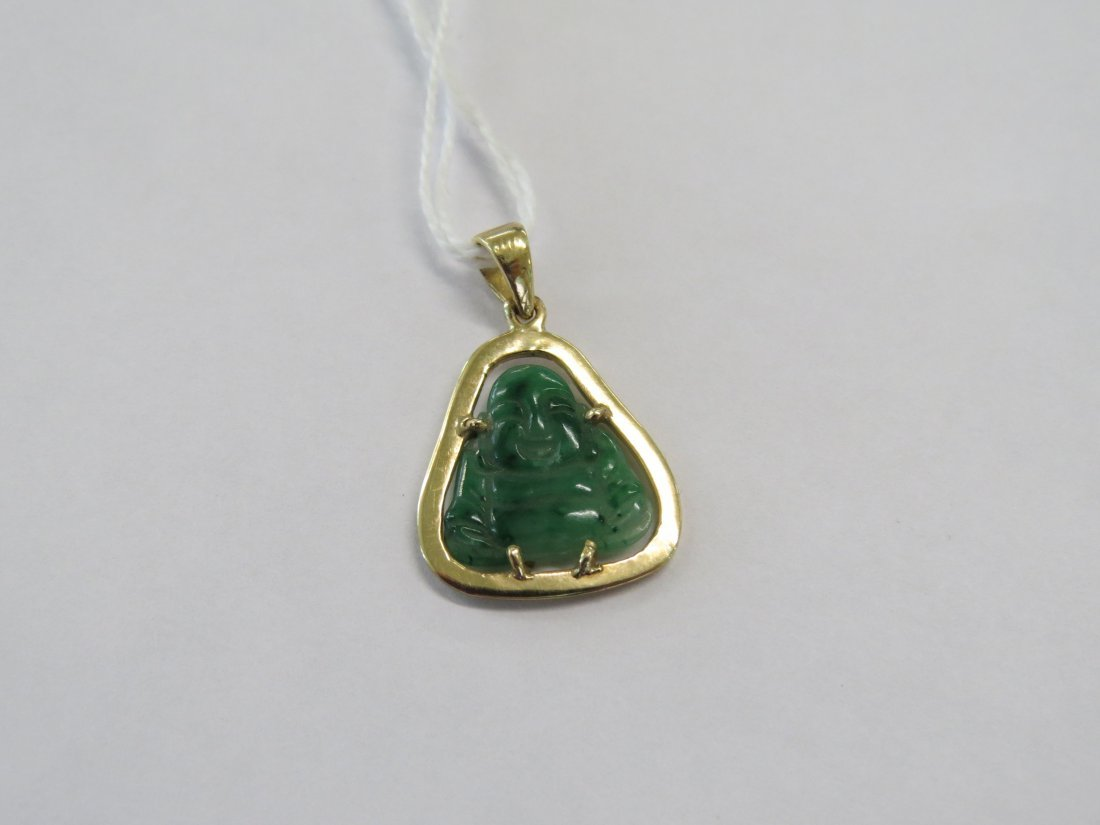 A Carved Jade Buddha Pendant. - 2
