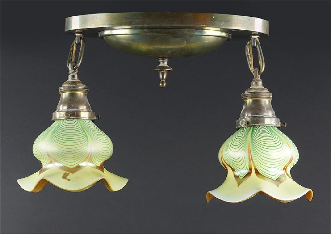 An Oval Brass Ceiling Mount Two-Light Fixture.