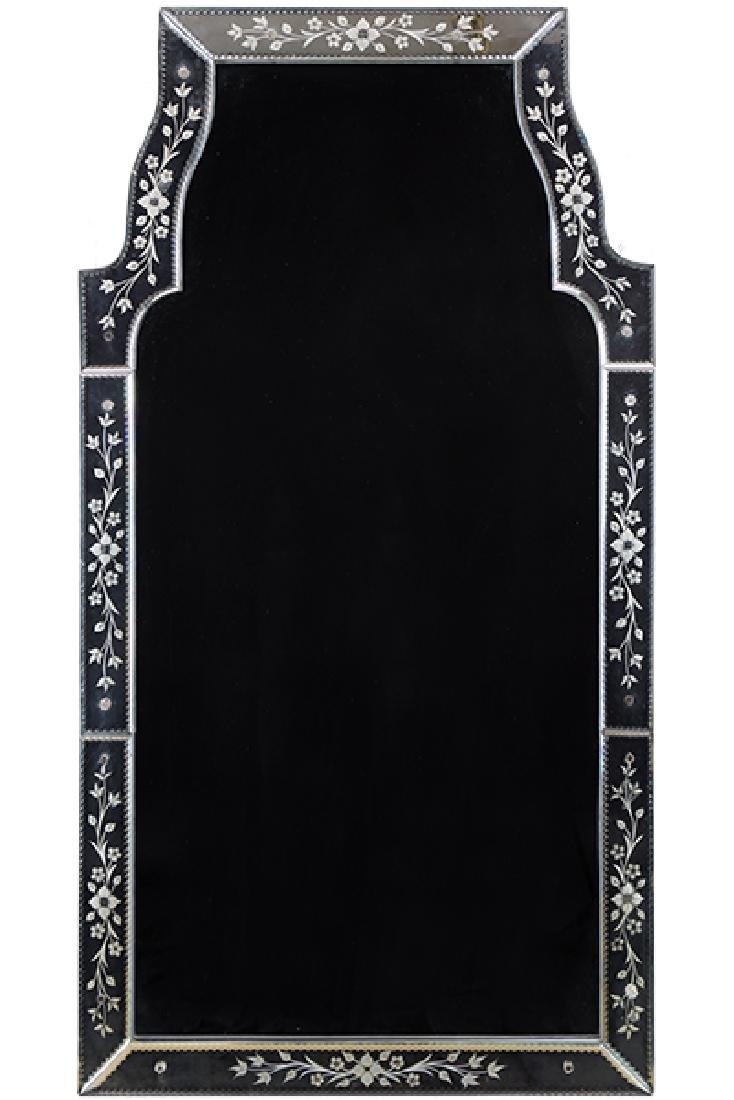 A Venetian Style Mirror.