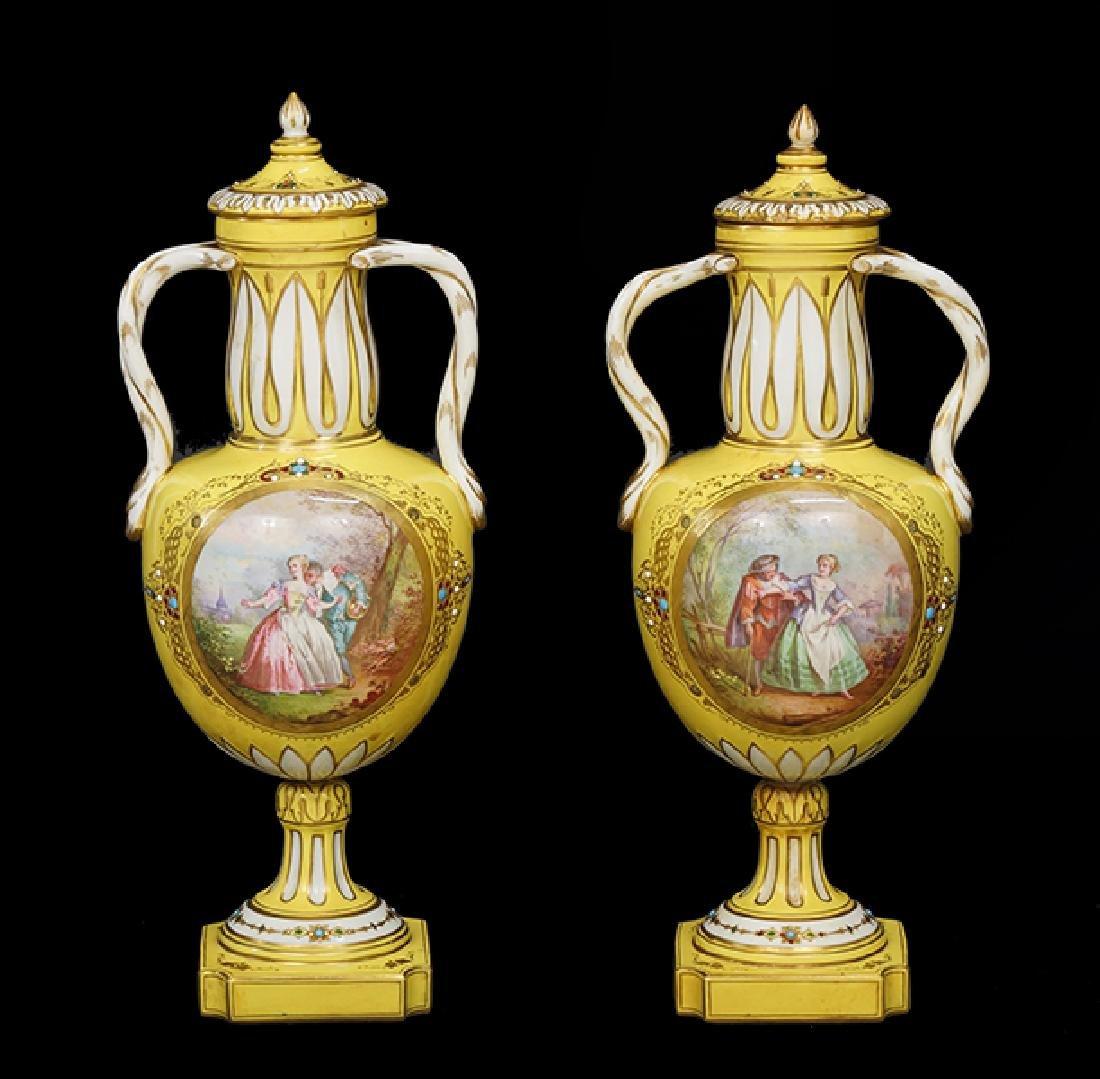 A Pair of Porcelain Urns.