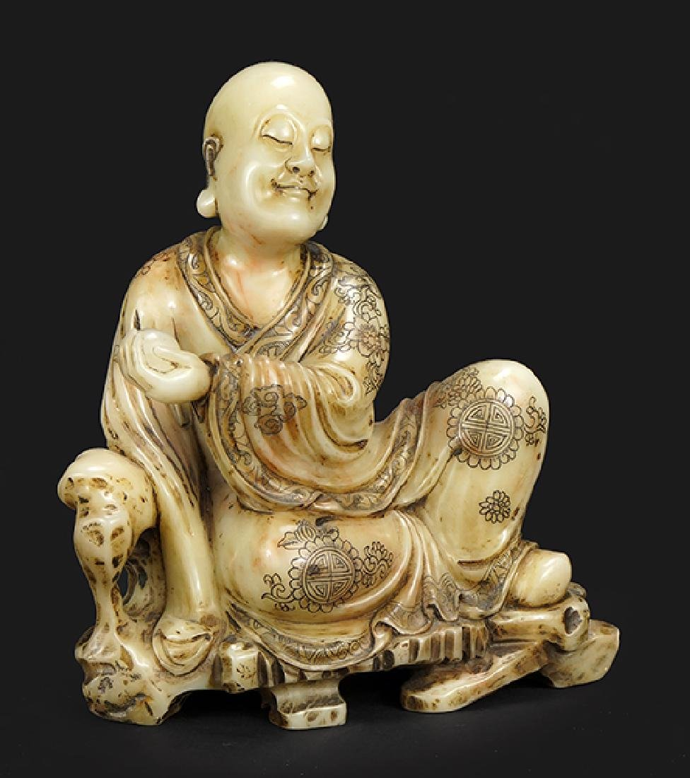 A Chinese Carved Soapstone Figure of a Seated Scholar.