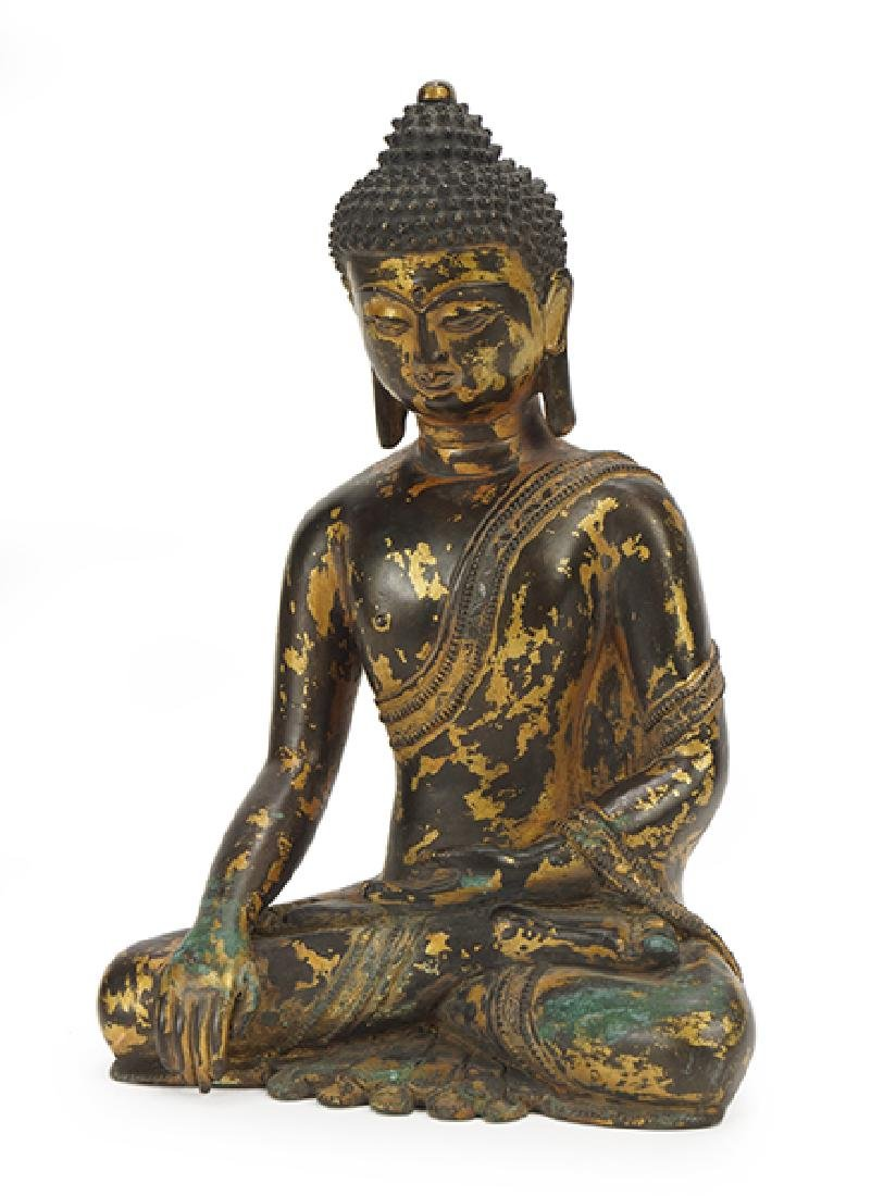 A Parcel Gilt Bronze Shakyamuni Buddha Figure.