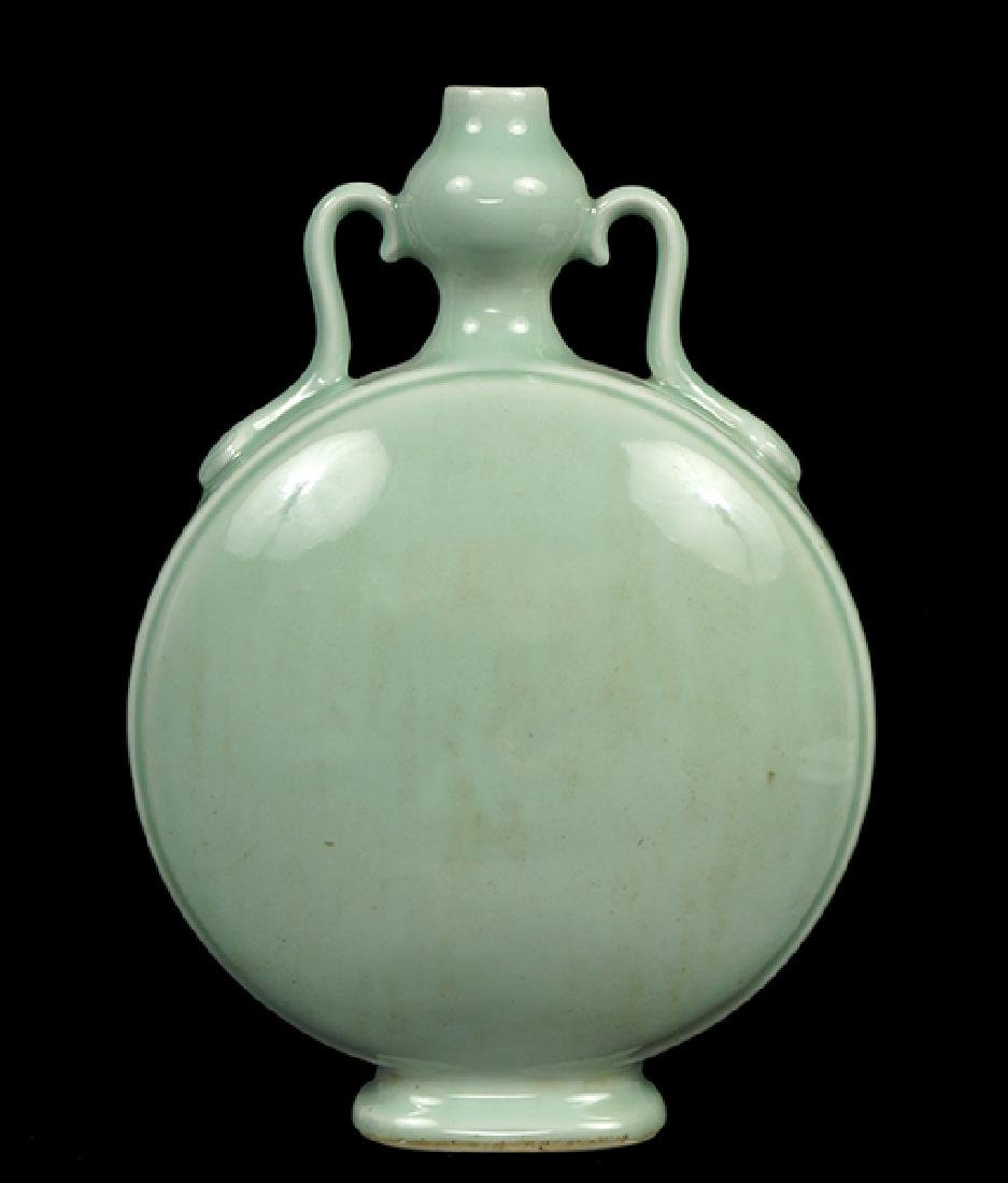 A Chinese Celadon Glazed Porcelain Moon Flask.