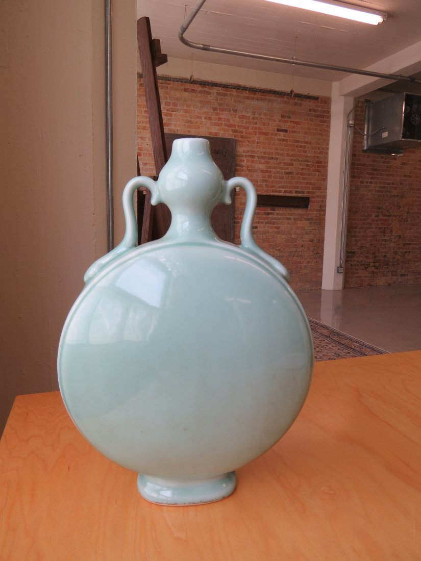 A Chinese Celadon Glazed Porcelain Moon Flask. - 2