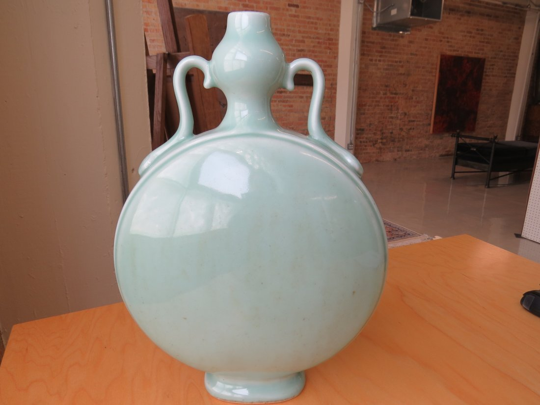 A Chinese Celadon Glazed Porcelain Moon Flask. - 4